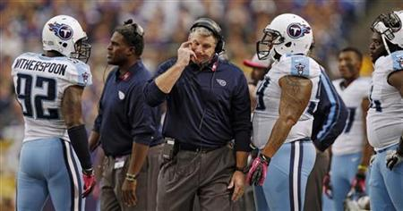Tennessee Titans head coach Mike Munchak walks on the sidelines after Tennessee cornerback Coty Sensabaugh is called for an unnecessary roughness penalty during the first half of their NFL football game against the Minnesota Vikings in Minneapolis, October 7, 2012. REUTERS/Eric Miller