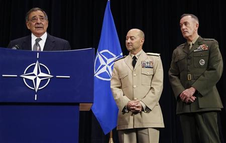 U.S. Secretary of Defense Leon Panetta addresses a news conference next to Supreme Allied Commander Europe (SACEUR) U.S. Navy Admiral James Stavridis (C) and U.S. Marine Corps General Joseph Dunford (R) during a NATO defence ministers meeting at the Alliance headquarters in Brussels October 10, 2012. REUTERS/Francois Lenoir