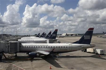 U.S. Airways planes are seen lined-up at a passenger terminal at the Charlotte Douglas International Airport in Charlotte, North Carolina July 15, 2012. REUTERS/Adrees Latif