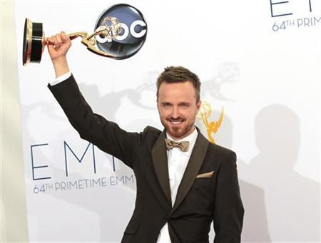 Aaron Paul raises the Emmy award for outstanding supporting actor for a drama series for his role in ''Breaking Bad'' at the 64th Primetime Emmy Awards in Los Angeles September 23, 2012. REUTERS/Mario Anzuoni
