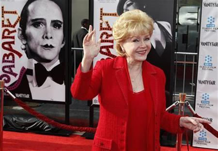 Actress Debbie Reynolds arrives at the world premiere of the 40th anniversary restoration of the film ''Cabaret'' during the opening night gala of the 2012 TCM Classic Film Festival in Hollywood, California April 12, 2012. REUTERS/Fred Prouser
