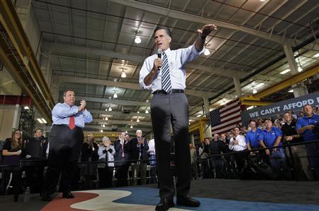 Republican presidential nominee Mitt Romney speaks as New Jersey Governor Chris Christie (L) claps during a town hall campaign stop at Ariel Corporation in Mount Vernon, Ohio October 10, 2012. REUTERS/Shannon Stapleton