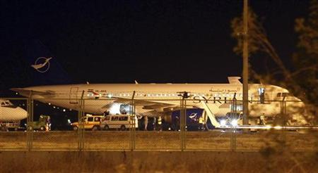 A Syrian passenger plane which was forced to land sits at Esenboga airport in Ankara October 10, 2012. REUTERS/Cem Oksuz/Anadolu Agency