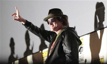 Director Quentin Tarantino gestures as he arrives for a panel for his film ''Django Unchained'' during the Comic Con International convention in San Diego, California July 14, 2012. REUTERS/Mario Anzuoni/Files