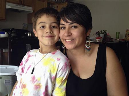 Luisa Garay poses with her eight-year-old son Miguel Chavarria in Las Vegas, Nevada, September 22, 2012. REUTERS/Margot Roosevelt