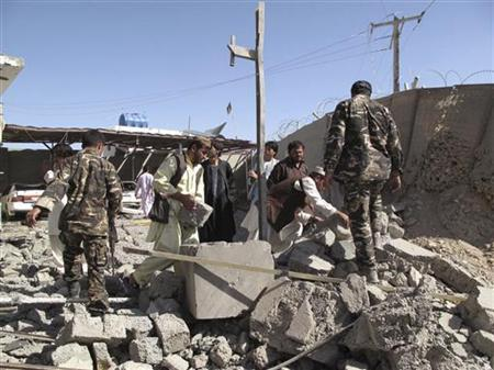 Afghan security forces investigate the site of a bomb blast in Helmand province October 8, 2012. REUTERS/Abdul Malik