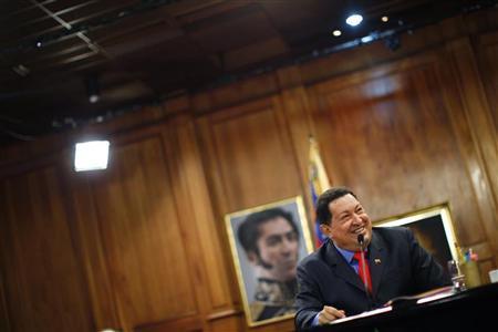Venezuelan President Hugo Chavez speaks during a news conference after winning elections in Caracas October 9, 2012. REUTERS/Jorge Silva
