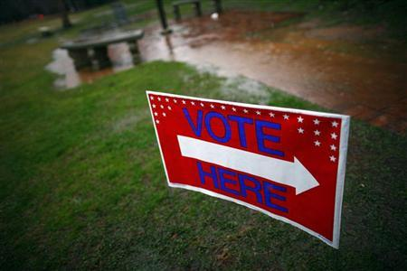 A sign is seen leading to a polling place at Powdersville Middle School in Greenville, South Carolina January 21, 2012. REUTERS/Eric Thayer