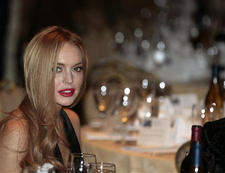 Actress Lindsay Lohan attends the White House Correspondents' Association annual dinner in Washington April 28, 2012. REUTERS/Larry Downing