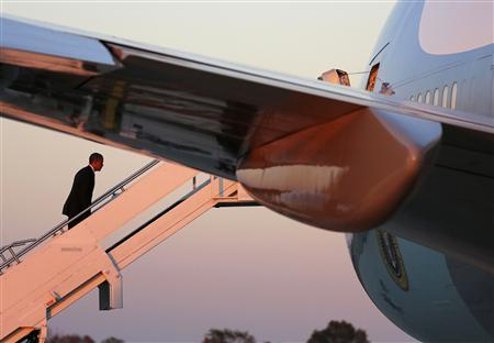 President Barack Obama walks up the steps of Air Force One before departing Rickenbacker Inland Port in Columbus, Ohio, ending a three-day campaign swing to California and Ohio, October 9, 2012. REUTERS/Larry Downing