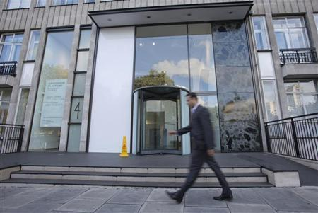 A man walks past the office building that houses Bumi Plc in London September 25, 2012. Picture taken September 25, 2012. REUTERS/Neil Hall