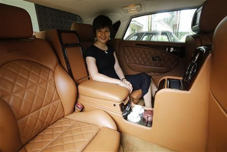 Bufori owner Tan eHong sits in her Bufori Geneva, which is fitted with a tea-making feature, at her residence in Kuala Lumpur September 27, 2012. REUTERS/Bazuki Muhammad