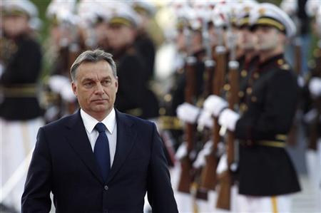 Hungary's Prime Minister Viktor Orban, accompanied by Georgia's President Mikheil Saakashvili, takes part in an official welcoming ceremony in Tbilisi, September 26, 2012. REUTERS/David Mdzinarishvili