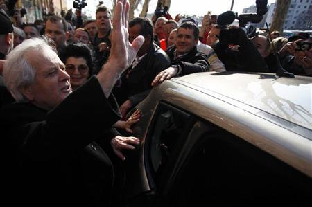 Former Bosnian Muslim warlord Fikret Abdic and his wife wave to citizens from Velika Kladusa in front of the prison in Pula March 9, 2012. REUTERS/Dado Ruvic