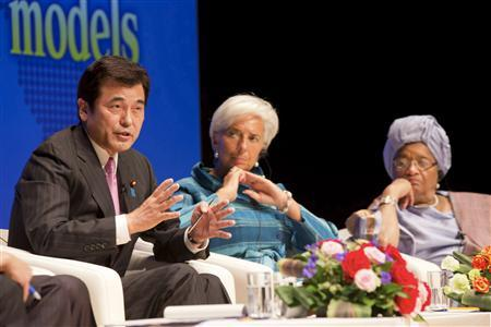 Japan's Finance Minister Koriki Jojima talks next to Head of the International Monetary Fund (IMF) Christine Lagarde (C) and Liberia's President Ellen Johnson Sirleaf (R) during the ''Globalization at a Crossroads: From Tokyo to Tokyo'' debate at the Tokyo International Forum October 11, 2012. REUTERS/Stephen Jaffe/IMF/Handout