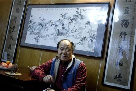 Chinese writer Mo Yan smiles during an interview at his house in Beijing December 24, 2009. REUTERS/China Daily