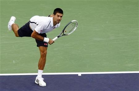 Serbia's Novak Djokovic serves against Spain's Feliciano Lopez during their singles tennis match at the Shanghai Masters tournament October 11, 2012. REUTERS/Carlos Barria