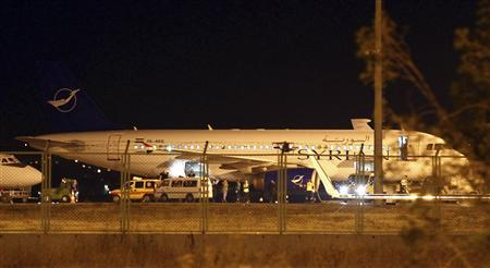 A Syrian passenger plane which was forced to land sits at Esenboga airport in Ankara October 10, 2012. Turkey scrambled fighter planes to force a Syrian passenger plane en route from Moscow to land in Ankara on Wednesday and banned Turkish civilian aircraft from flying in Syrian airspace, state-run TRT television said. REUTERS/Cem Oksuz/Anadolu Agency