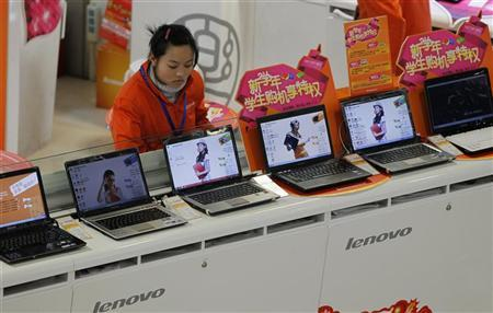 A salesperson waits for customers at a Lenovo shop in Shanghai February 17, 2011. REUTERS/Aly Song