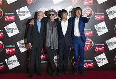 "The Rolling Stones (L-R) Charlie Watts, Keith Richards, Ronnie Wood and Mick Jagger pose as they arrive for the opening of the exhibition ""Rolling Stones: 50"" at Somerset House in London July 12, 2012. The exhibition which celebrates 50 years of the band since their first gig at the Marquee Club in 1962 will run from July 13 to August 27. REUTERS/Ki Price"