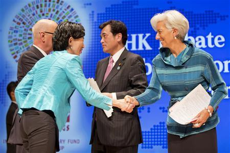 Head of the International Monetary Fund (R) Christine Lagarde shakes hands with moderator NHK anchor Kaori Iida next to Japan's Finance Minister Koriki Jojima (2nd R) and Klaus Schwab, founder and executive chairman of the World Economic Forum, during the ''Globalization at a Crossroads: From Tokyo to Tokyo'' debate at the Tokyo International Forum October 11, 2012. REUTERS/Stephen Jaffe/IMF/Handout