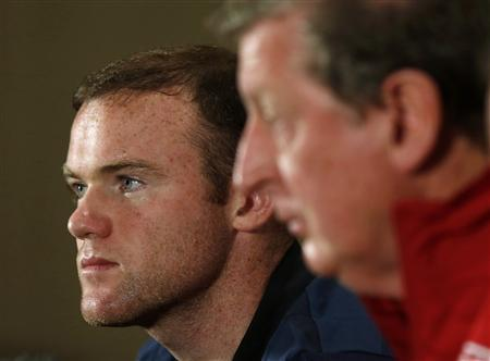 England's national soccer team manager Roy Hodgson (R) and captain Wayne Rooney attend a media conference at the team's hotel in Watford, north of London October 11, 2012. England are due to play San Marino in a 2014 World Cup qualifier on Friday in London. REUTERS/Eddie Keogh