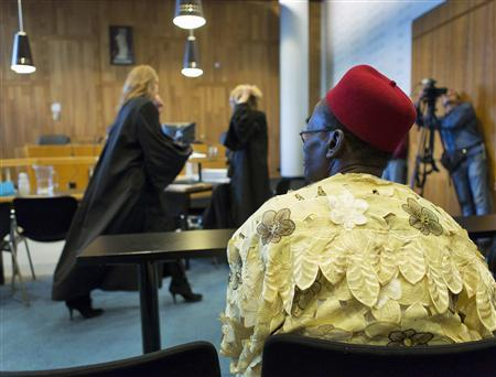 Chief Fidelis Oguru (R), a representative of both fishermen and farmers from Nigeria, sits in a local court in The Hague October 11, 2012. REUTERS/Michael Kooren