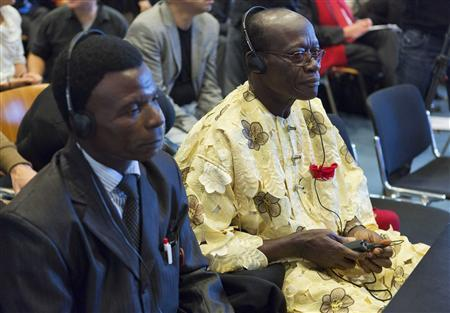 Chief Fidelis Oguru (R) and Friday Alfred Akpan, representatives of both fishermen and farmers from Nigeria, sit in a local court in The Hague October 11, 2012. REUTERS/Michael Kooren