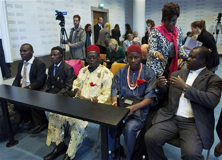 Alali Efanga (L), Friday Alfred Akpan (2nd L), Chief Fidelis Oguru (C) Eric Dooh (2nd R), all representatives of farmers from Nigeria, and Chima Williams of Environmental Rights Action are seen in a local court in The Hague October 11, 2012. REUTERS/Michael Kooren