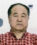 """<p>El escritor chino Mo Yan durante un evento literario en Hangzhou, China, sep 11 2012. El escritor chino Mo Yan ganó el jueves el premio Nobel de Literatura 2012 por una obra en la que combina un """"alucinante realismo"""" con relatos populares, historia y elementos contemporáneos de su país natal, anunció la academia sueca que otorga el galardón. REUTERS/China Daily</p>"""