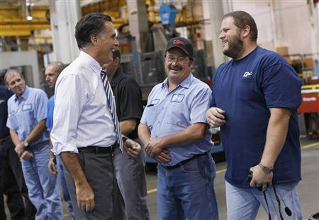 Republican presidential nominee Mitt Romney smiles while meeting members of the assembly line at Ariel Corporation before a town hall campaign stop in Mount Vernon, Ohio October 10, 2012. REUTERS/Shannon Stapleton