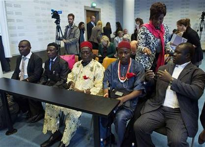 Alali Efanga (L), Friday Alfred Akpan (2nd L), Chief Fidelis Oguru (C) Eric Dooh (2nd R), all representatives of farmers and fishermen from Nigeria, and Chima Williams of Environmental Rights Action are seen in a local court in The Hague October 11, 2012. REUTERS/Michael Kooren