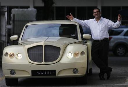 Bufori's founder and managing director Gerry Khouri poses with a Bufori Geneva at its plant in Kuala Lumpur September 10, 2012. The global economic doldrums may have weighed on businesses around the world, but in Malaysia, a luxury hand-crafted carmaker struggles to keep up with demand as orders pour in from Asia and the Middle East, with some customers willing to wait almost two years for their Bufori vehicle. Picture taken September 10, 2012. To match story MALAYSIA-BUFORI/ REUTERS/Bazuki Muhammad