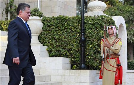 Jordan's King Abdullah (L) leaves after the swearing-in ceremony for the new cabinet at the Royal Palace in Amman October 11, 2012. King Abdullah swore in a new government on Thursday led by reformist politician Abdullah Ensour and charged with preparing for Jordan's first post-Arab Spring parliamentary elections. REUTERS/Muhammad Hamed