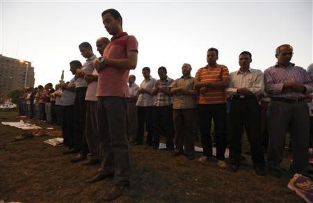 Members of the Muslim Brotherhood pray during a protest against general prosecutor Abdel Maguid Mahmoud and the Mubarak regime at Tahrir Square, the focal point of the Egyptian uprising, in Cairo October 11, 2012. Egypt's president removed the general prosecutor from his post on Thursday, appeasing demonstrators who accused him of presenting weak evidence in a case against Mubarak-era officials accused of planning attacks on protesters last year. REUTERS/Amr Abdallah Dalsh