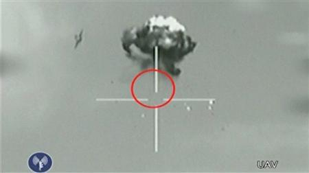 A still image taken from Israeli Defence Forces (IDF) video footage shows what they say is a small unidentified aircraft shot down in a mid-air interception after it crossed into southern Israel October 6, 2012. Hezbollah leader Sayyed Hassan Nasrallah acknowledged on October 11, 2012, sending a drone aircraft which was shot down last weekend after flying some 25 miles (55 km) into Israel. Image taken October 6, 2012. REUTERS/IDF via Reuters TV
