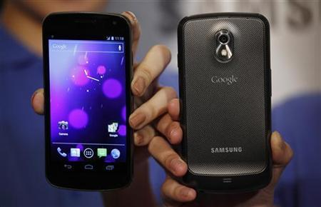 Models pose with the Galaxy Nexus, the first smartphone to feature Android 4.0 Ice Cream Sandwich and a HD Super AMOLED display, during a news conference in Hong Kong in this file photo taken October 19, 2011. REUTERS/Bobby Yip