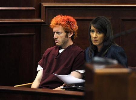 James Eagan Holmes (L) sits with public defender Tamara Brady during his first court appearance in Aurora, Colorado, July 23, 2012. REUTERS/RJ Sangosti/Pool