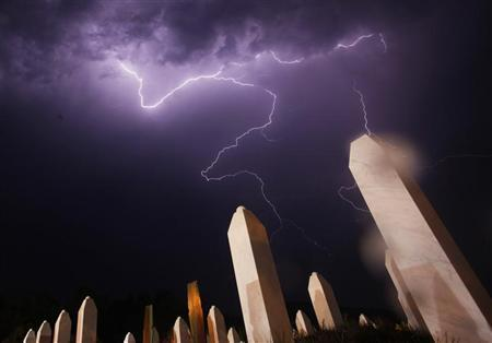 Lightning is seen during a storm under the Memorial Center in Potocari the night before a mass burial, near Srebrenica July 10, 2012. REUTERS/Dado Ruvic