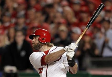 Washington Nationals' Jayson Werth hits a game-winning walk-off solo home run against the St. Louis Cardinals during the ninth inning in Game 4 of their MLB NLDS baseball series in Washington October 11, 2012. REUTERS/Gary Cameron