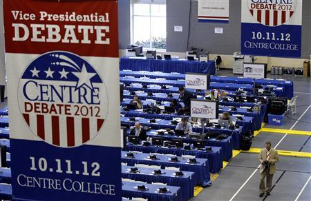 Members of the media work on the Centre College campus before the vice-presidential debate in Danville, Kentucky October 10, 2012. U.S. vice presidential debates usually don't matter much, but the October 11 showdown between Democratic incumbent Joe Biden and Republican challenger Paul Ryan could be an exception. REUTERS/Matt Sullivan