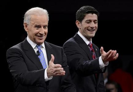 U.S. Vice President Joe Biden (L) and Republican vice presidential nominee Paul Ryan react at the conclusion of the U.S. vice presidential debate in Danville, Kentucky October 11, 2012. REUTERS/Michael Reynolds/Pool
