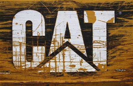 A scratched and worn Caterpillar logo is pictured at the back of a bulldozer in the rental equipment yard of Holt Caterpillar, the largest Caterpillar dealer in the United States, in San Antonio, Texas March 19, 2012. REUTERS/Richard Carson
