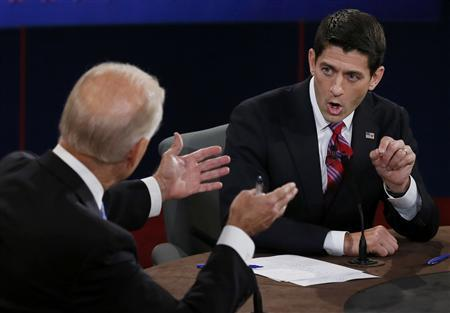 Vice President Joe Biden (L) and Republican vice presidential nominee Paul Ryan discuss a point during the vice presidential debate in Danville, Kentucky, October 11, 2012. REUTERS/Rick Wilking