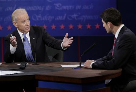 U.S. Vice President Joe Biden (L) gestures towards Republican vice presidential nominee Paul Ryan as they discuss a point during the U.S. vice presidential debate in Danville, Kentucky, October 11, 2012. REUTERS/John Gress