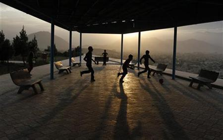 Afghan boys play football on a hill in Kabul September 11, 2012. REUTERS/Mohammad Ismail/Files