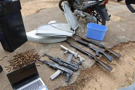 Guns, ammunitions and electronic gadgets seized from suspected Islamic sect members of Boko Haram are displayed, following a raid conducted on Monday, in a military barrack in northern city of Kano September 18, 2012. REUTERS/Stringer/Files
