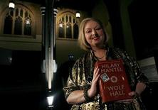 "Author Hilary Mantel poses with her book ""Wolf Hall"" after winning the 2009 Man Booker Prize for Fiction at the Guildhall in London October 6, 2009. REUTERS/Luke MacGregor"