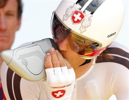 Switzerland's Fabian Cancellara takes a drink befor starting in the men's cycling individual time trial at the London 2012 Olympic Games August 1, 2012. REUTERS/Cathal McNaughton
