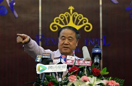 Chinese writer Mo Yan gestures during a news conference in his hometown of Gaomi, Shandong province October 12, 2012. Chinese Nobel Literature Prize winner Mo Yan said on Friday that he hoped the jailed 2010 Nobel Peace Prize winner, Liu Xiaobo, can ''achieve freedom soon''. REUTERS/Jason Lee